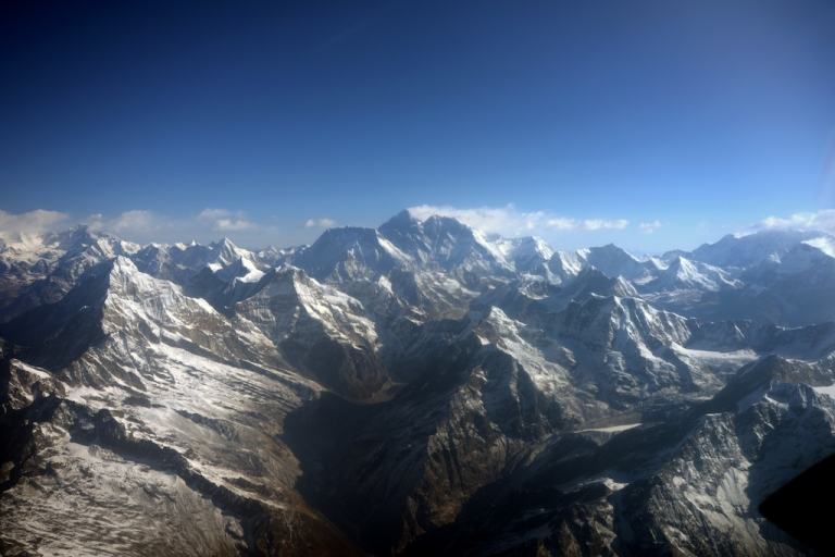 <p>This photograph taken from an aircraft shows an aerial view of Mount Everest (C) and The Himalayan mountain range, some 140kms (87 miles) north-east of Kathmandu on April 3, 2013, on the 80th anniversary of the first manned flight over Mount Everest, the world's tallest mountain. This year is the 60th anniversary of the first summit of the 8848-meter peak.</p>