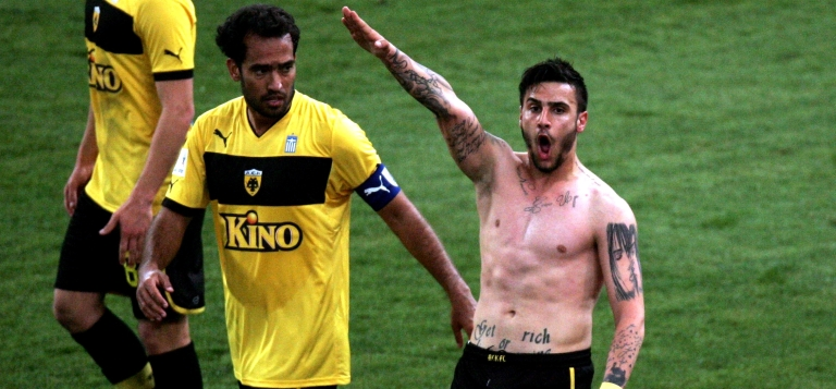 <p>Greek soccer player Giorgos Katidis celebrates a goal with a Nazi salute during a match in Athens.</p>