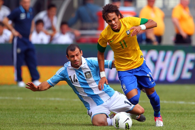 <p>Javier Mascherano #14 of Argentina makes a slide tackle on the ball controlled by Neymar #11 of Brazil during the second half of an international friendly soccer match on June 9, 2012 at MetLife Stadium in East Rutherford, New Jersey.</p>