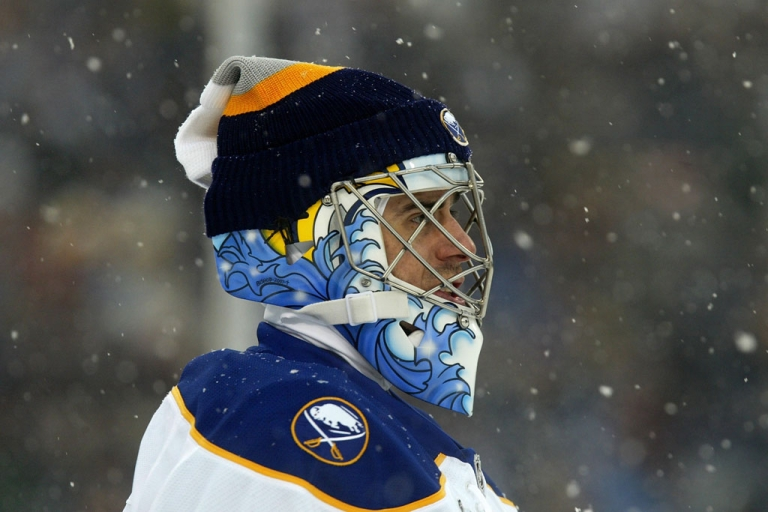<p>Snow falls on goaltender Ryan Miller of the Buffalo Sabres during the NHL Winter Classic against the Pittsburgh Penguins at the Ralph Wilson Stadium on January 1, 2008 in Orchard Park, New York. The Penguins won the game 2-1 in a shootout.</p>