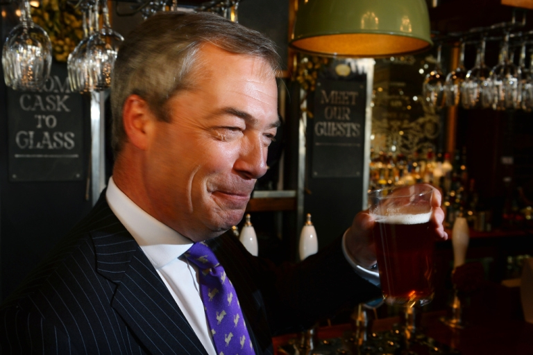 <p>UK Independent Party leader Nigel Farage enjoys a pint of beer in a pub in central London on May 3, 2013. The anti-immigration UKIP was celebrating some of its best ever results following local elections which delivered a bloody nose to Britain's ruling coalition.</p>
