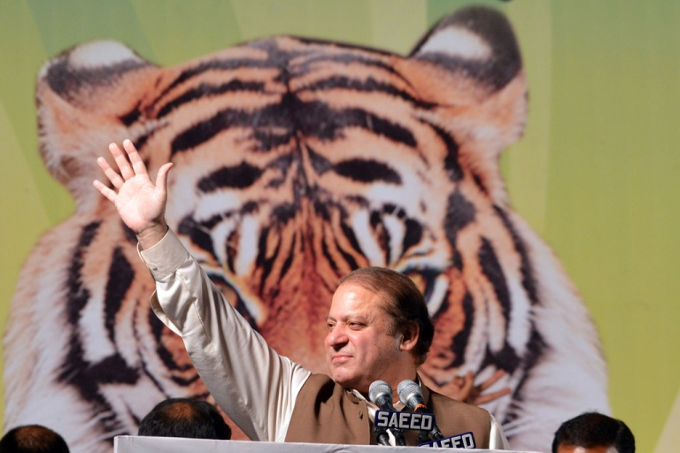 <p>Former Pakistani Prime Minister Nawaz Sharif waves as he addresses his supporters during an election campaign meeting in Islamabad on May 5, 2013. A roadside bomb exploded at an election rally in southwest Pakistan on May 5 killing two people, officials said as violence continued ahead of historic polls on Saturday. Pakistan will elect its new government for the next five years in polls on May 11. The election of the national and four provincial assemblies will mark the first time a civilian government has completed a full term and handed over to another, in a country that has been ruled by the military for half its existence.</p>