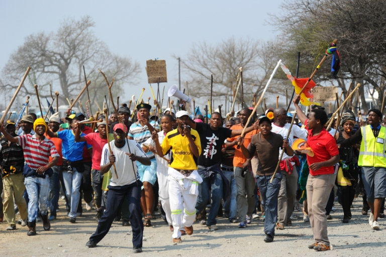 <p>Thousands of miners of South Africa's strike-hit platinum belt gather for a rally on September 13, 2012 in Rustenurg, a day after bringing the world's top producer of the precious metal to a standstill. Miners in South Africa may strike once again as a restructuring plan may cut as many as 14,000 jobs.</p>