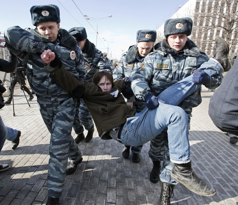 <p>Policemen detain a protester calling for the release of two jailed members of the Pussy Riot protest punk band in central Moscow on March 8, 2013.</p>