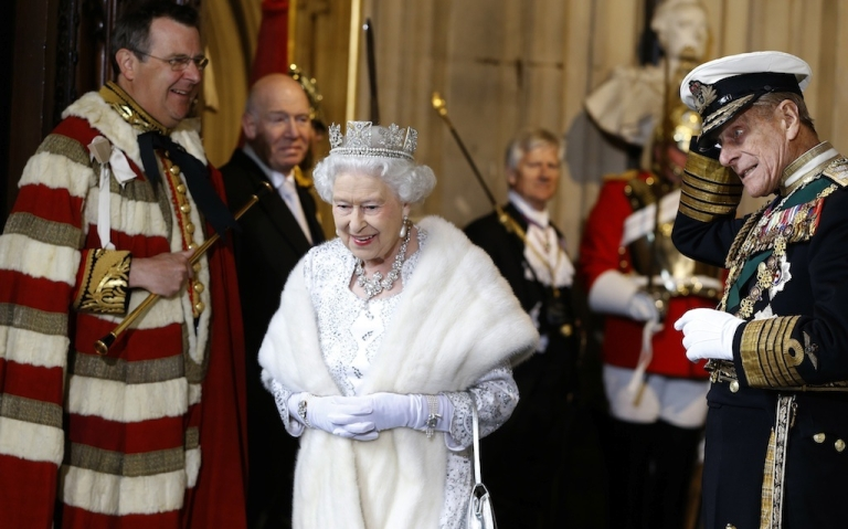 <p>Britain's Queen Elizabeth II smiles with The Duke of Edinburgh (R) as they leave after the State Opening of Parliament, at the Houses of Parliament in London on May 8, 2013 . British Prime Minister David Cameron pledged a fresh clampdown on immigration in the Queen's Speech on Wednesday, seeking to bolster his right-wing credentials and counter the rise of the UK Independence Party (UKIP).</p>