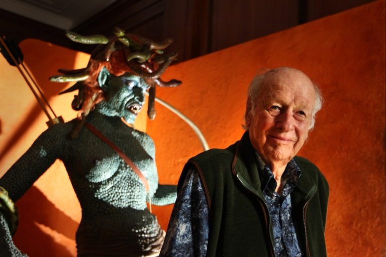 <p>Special-effects pioneer Ray Harryhausen poses with a Medusa from his 1981 film