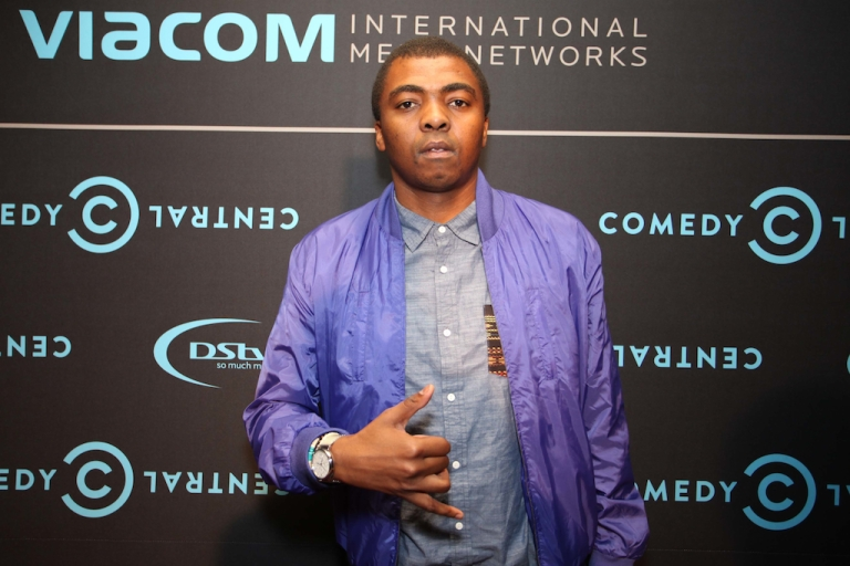 <p>JOHANNESBURG, SOUTH AFRICA - Loyiso Gola attend  the Comedy Central Roast of Steve Hofmeyer at the Lyric Theatre, Gold Reef City on September 11, 2012 in Johannesburg, South Africa.  Gola hosts Late Nite News with Loyiso Gola, basically an equivalent of Jon Stewart's The Daily Show, but broadcast on a national news network.</p>