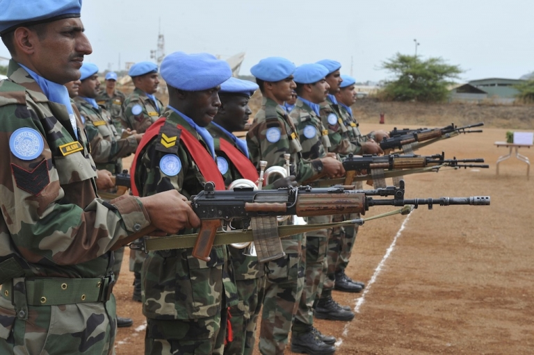 <p>UN peacekeepers in Juba during a funeral ceremony for the five Indian peacekeepers killed during an ambush in the eastern region of Jonglei, on April 10, 2013</p>