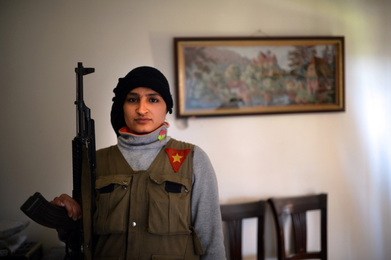 <p>Sawoushka Ahmed, a Kurdish female fighter stands with a gun in the majority-Kurdish Sheikh Maqsud district of the northern Syrian city of Aleppo on April 14, 2013.</p>