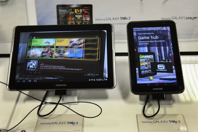<p>Samsung Galaxy tablets are offered for sale at a Tiger Direct store on April 11, 2013 in Chicago. Chinese shoppers in the next 12 months will use mobile devices to shop at double the rate of anyone else, according to the latest PricewaterhouseCoopers (PWC) survey.</p>