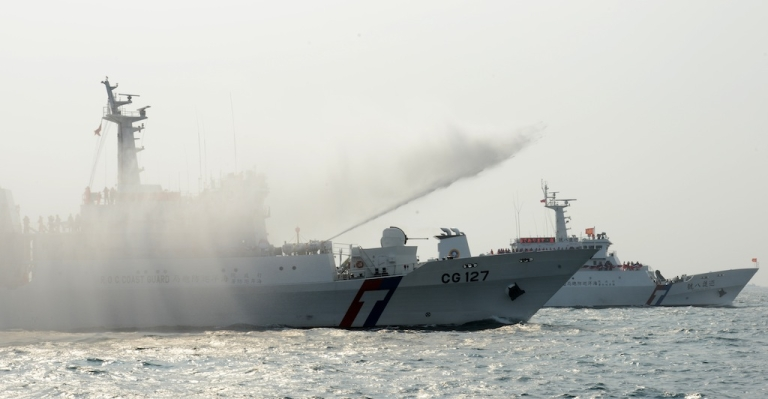 <p>Taiwan coast guard ships during a demonstration in southern Kaohsiung city on March 30, 2013. Taiwan launched military drills on Thursday in the waters separating it from the Philippines, where a Taiwanese fisherman was shot and killed last week.</p>
