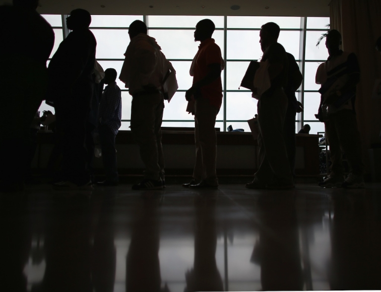 <p>People looking for work stand in line to apply for a job during a job fair at the Miami Dolphins Sun Life stadium on May 2, 2013 in Miami, Florida. Unemployment dropped to a 4-year low in April, according to new stats.</p>