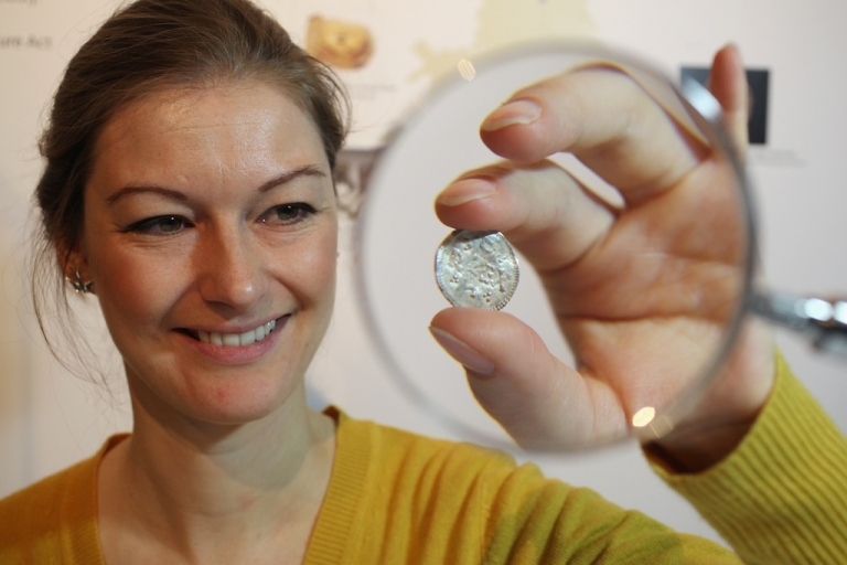 <p>An employee of the British Museum examines a silver coin dating from 900 AD which is part of the Silverdale Viking Hoard on December 14, 2011 in London, England. The picture does not depict the latest group of Viking coins found last year by a Danish teen in Denmark.</p>