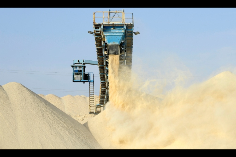 <p>A picture taken on May 13, 2013 shows untreated phosphate being dropped off the end of a conveyor belt at the national Moroccan phosphates company's Marca factory.</p>