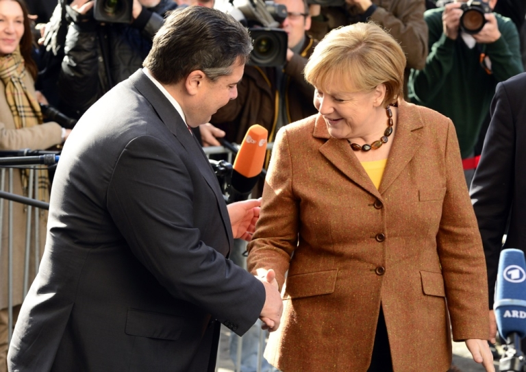 <p>German Chancellor Angela Merkel shakes hands with Sigmar Gabriel, leader of Germany's social democratic SPD party. Merkel's conservative CDU/CSU union and the SPD agreed the terms of a coalition pact on November 27, 2013.</p>