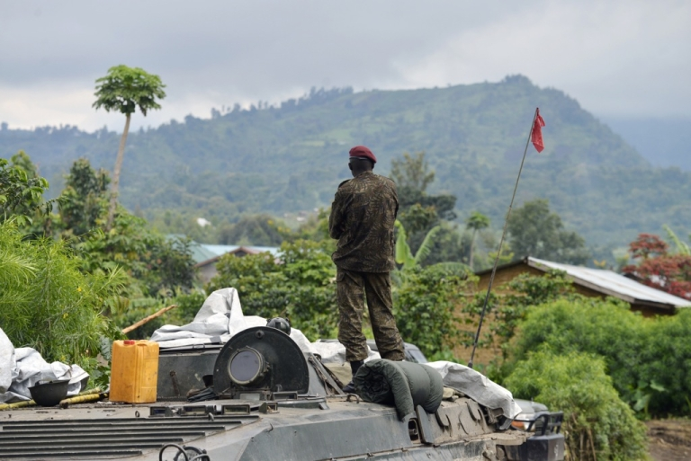<p>A Democratic Republic of Congo soldier in Rutshuru on November 4, 2013, after the army recaptured the area from M23 rebels. On November 5, the rebels declared that they would ended their armed insurgency after 20 months of conflict in eastern Congo.</p>