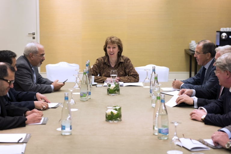 <p>Iranian Foreign Minister Mohammad Javad Zarif gestures next to EU High Representative for Foreign Affairs Catherine Ashton during a meeting on the third day of talks on Iran's nuclear program on November 9, 2013 in Geneva.</p>