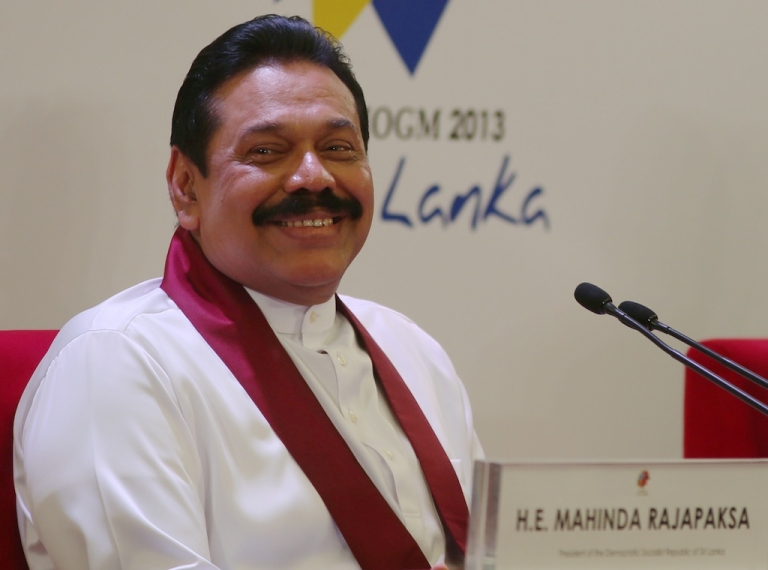 <p>Sri Lankan President Mhainda Rajapaksa smiles during the pre-Commonwealth Heads of Government Meeting press conference at Bandaranaike Memorial International Conference Hall on November 14, 2013 in Colombo, Sri Lanka.</p>