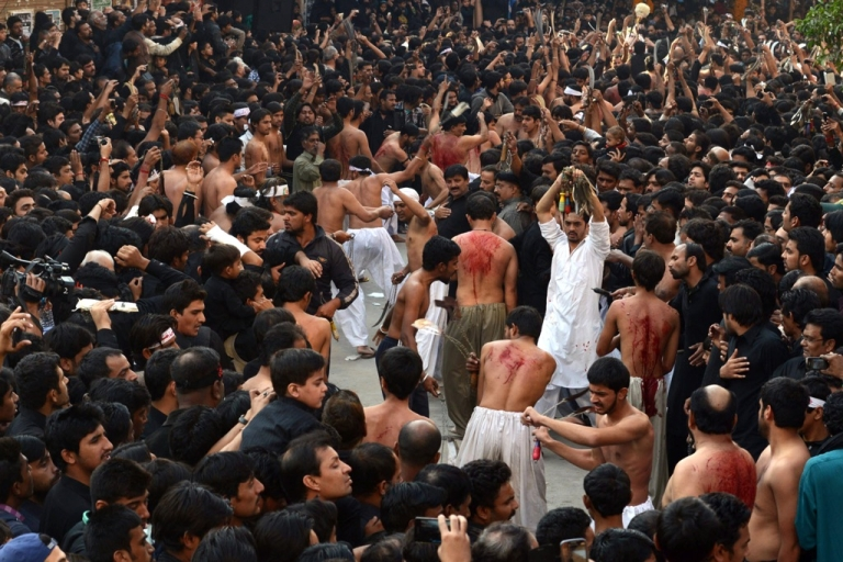 <p>Pakistani Shiite Muslims participate in ritual self-flagellation during a religious procession held ahead of Ashura on the ninth day of Muharram in Lahore on Nov. 14, 2013. Ashura mourns the death of Imam Hussein, a grandson of the Prophet Mohammed, who was killed by armies of the Yazid near Karbala in 680 AD.</p>