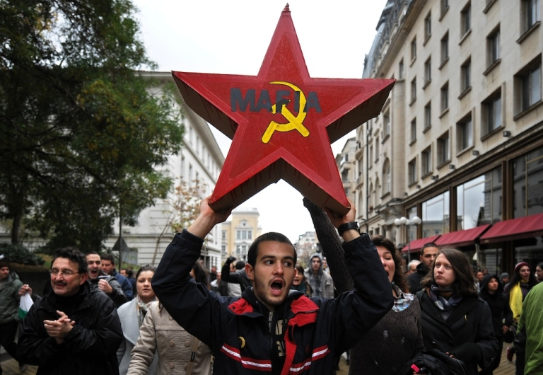 <p>A student holds a red star, symbol of the former communist regime, during an anti-government protest in center of Sofia on November 15, 2013. The protest followed months of street tensions in the European Union's poorest country and came few days after students padlocked Sofia University demanding the resignation of Prime Minister Plamen Oresharski's embattled Socialist-backed government.</p>