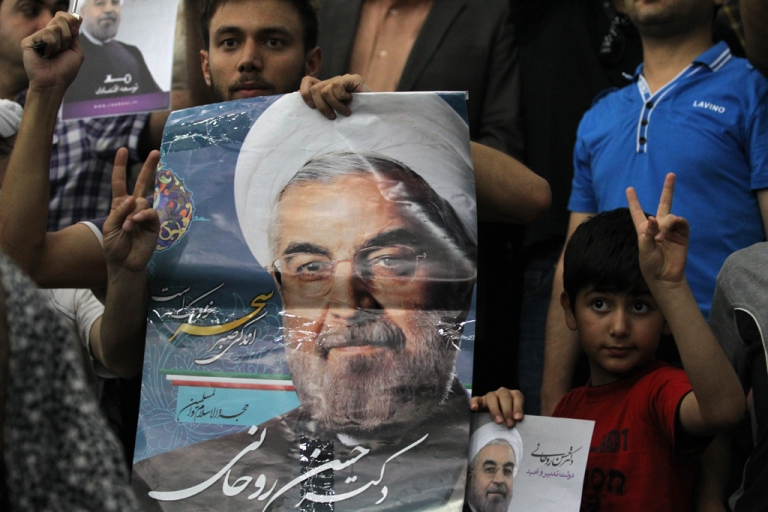 <p>Iranian supporters of President-elect Hassan Rouhani gather at the mausoleum of the founder of Iran's Islamic Republic, Ayatollah Ruhollah Khomeini, in Tehran on June 16, 2013, during a visit for Rouhani to the mausoleum. Rouhani hailed his presidential election win as a victory over 'extremism' as jubilant supporters took to the streets, pinning their hopes on an easing of Western sanctions.</p>