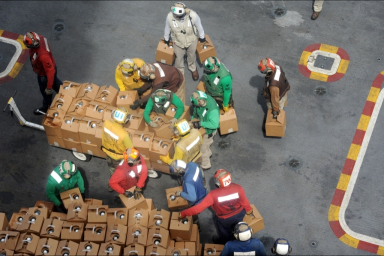 <p>US sailors stack relief supplies on the flight deck of the Navy's USS George Washington aircraft carrier in the aftermath of Typhoon Haiyan.</p>