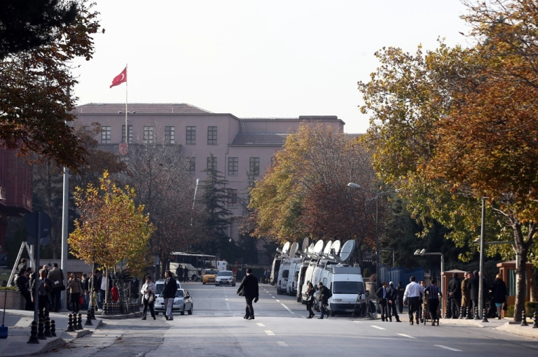 <p>Security officials close a road leading to Turkish Prime Minister's office shortly after police subdued a man who was carrying a fake bomb in Ankara on November 21, 2031.</p>