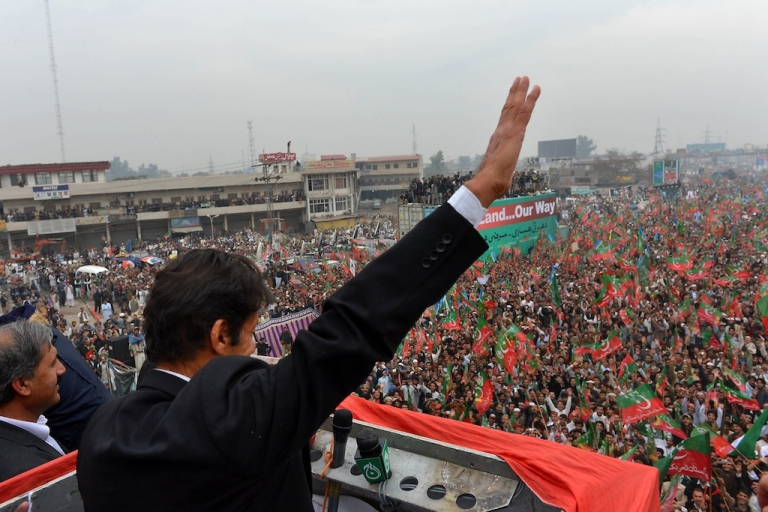 <p>Imran Khan, Chairman of Pakistan Tehreek-e-Insaaf (PTI) party, gestures while addressing a protest rally in Peshawar on November 23, 2013.</p>