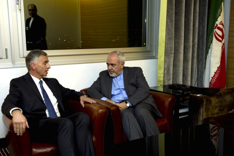 <p>Switzerland's Foreign Minister Didier Burkhalter talks with Iranian Foreign Minister Mohammad Javad Zarif during a meeting at the Intercontinental Hotel prior to talks about Iran's nuclear program in Geneva on November 23, 2013.</p>