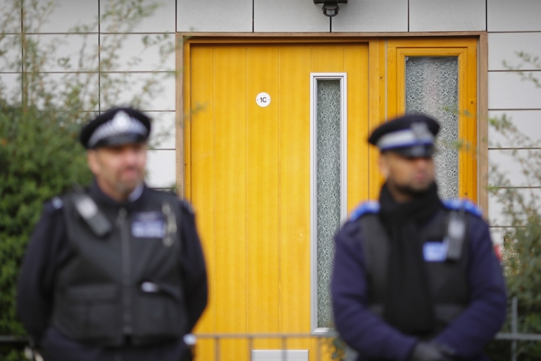 <p>Police continue to stand guard for a second day outside a South London block of flats that is being investigated in connection with an alleged slavery case on November 24, 2013 in London, England.</p>