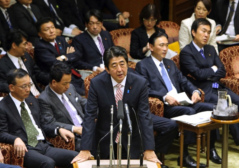<p>Japanese Prime Minister Shinzo Abe answers a question during the Upper House's audit committee session at the National Diet in Tokyo on November 25, 2013. China's declaration of an air defence identification zone that includes disputed islands is 'profoundly dangerous', Japan's prime minister said.</p>