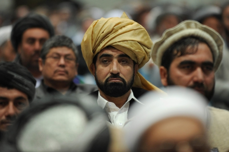 <p>Delegates listen to Afghan President Hamid Karzai deliver a speech during a four-day long loya jirga, a meeting of over 2,000 Afghan tribal elders and leaders in Kabul in November 2011.</p>