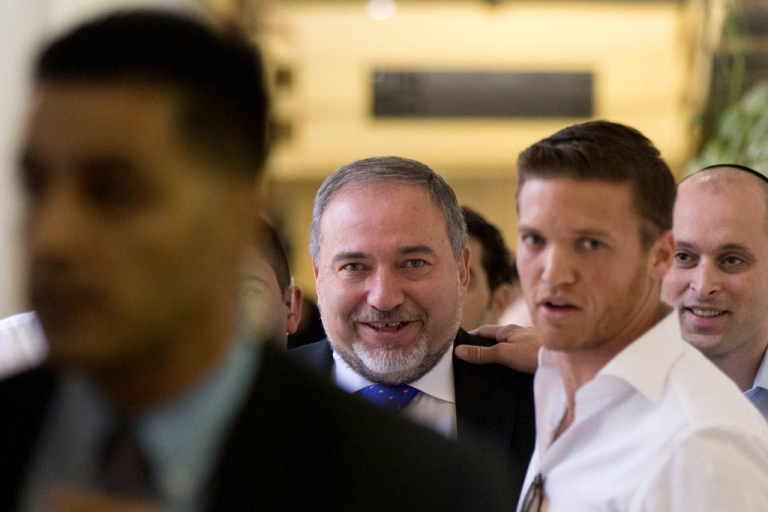 <p>Former Israeli Foreign Minister Avigdor Lieberman (C) as he exits the courtroom after hearing the verdict in his trial on charges of fraud and breach of trust, on November 6, 2013 in Jerusalem, Israel.</p>