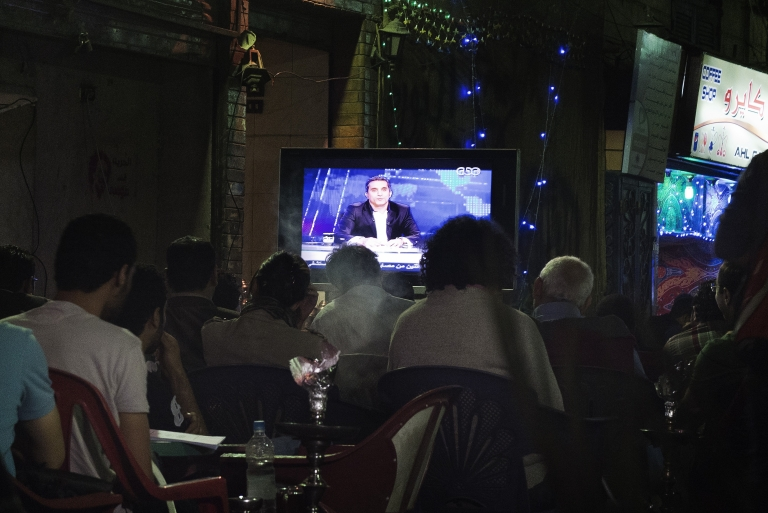 <p>Egyptians watch comedian Bassem Youssef's show as they sit at a public coffee shop in Cairo on April 5, 2013. Youssef's wildly popular program was pulled from the air suddenly Friday after its network accused the show of violating editorial policies.</p>