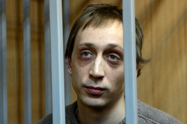 <p>Pavel Dmitrichenko, a former dancer at Russias Bolshoi Theatre, looks on as he stands inside the defendant's cage during a court hearing in Moscow, on October 22, 2013.</p>