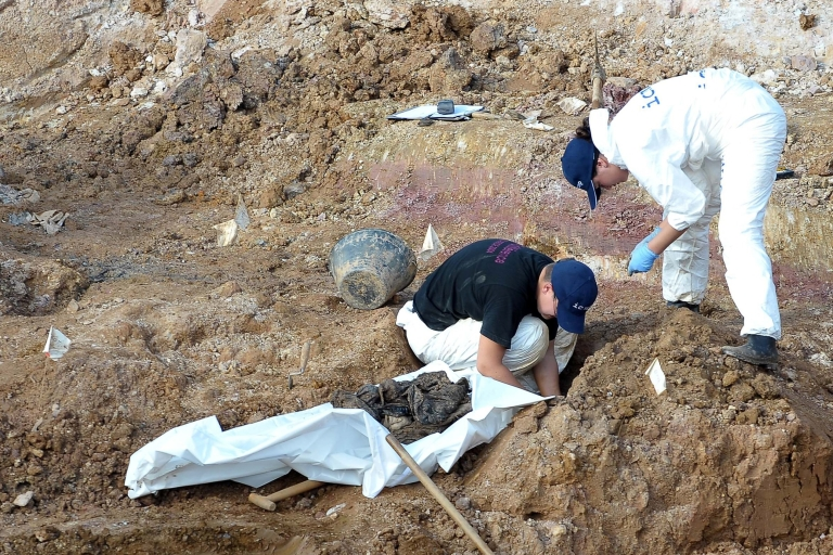 <p>Forensic experts at a mass grave in western Bosnia last month search for human remains believed to have belonged to Muslims and Croats killed by Serb forces. The authorities are still searching for 1,200 people missing from the area.</p>
