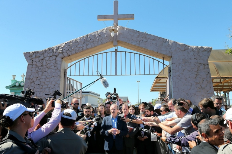 <p>The governor of Rio Grande do Sul, Tarso Genro, speaks with the press on Nov. 13, 2013 outside the cemetery where the remains of former Brazilian President (1961-1964) João Goulart — commonly named Jango — lie. The remains of Goulart, deposed by a military coup d'etat, will be exhumed to determine whether he was poisoned during his exile in Argentina in the 1970s.</p>