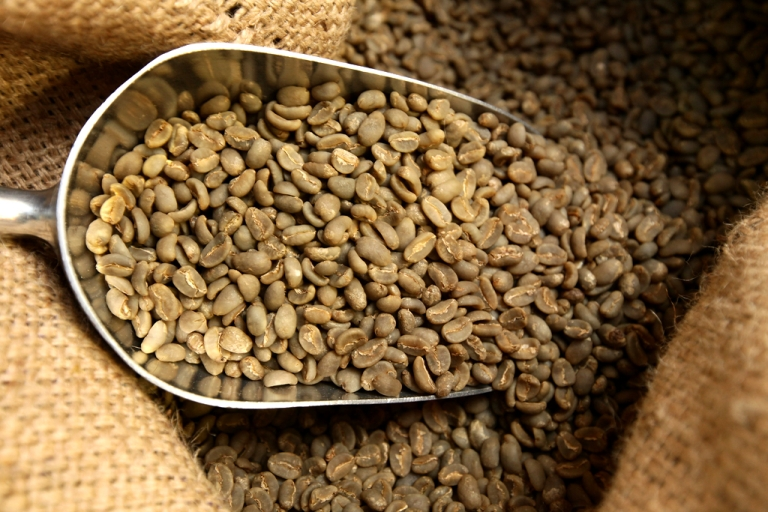 <p>Raw coffee beans imported from Brazil lie in sacks in Berlin, Germany.</p>