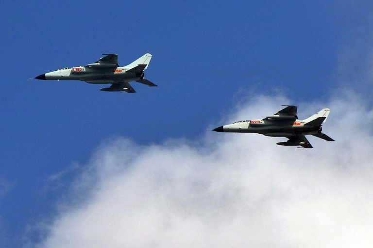 <p>Chinese People's Liberation Army (PLA) fighter jets leave their base in Shanghai on October 23, 2013.</p>