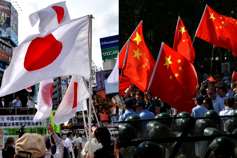 <p>Japanese nationalists, on the left, and Chinese nationalists, on the right, protesting over the disputed islands in the East China Sea on September 18, 2012. Japan knows them as the Senkaku Islands and China calls them Diaoyu.</p>