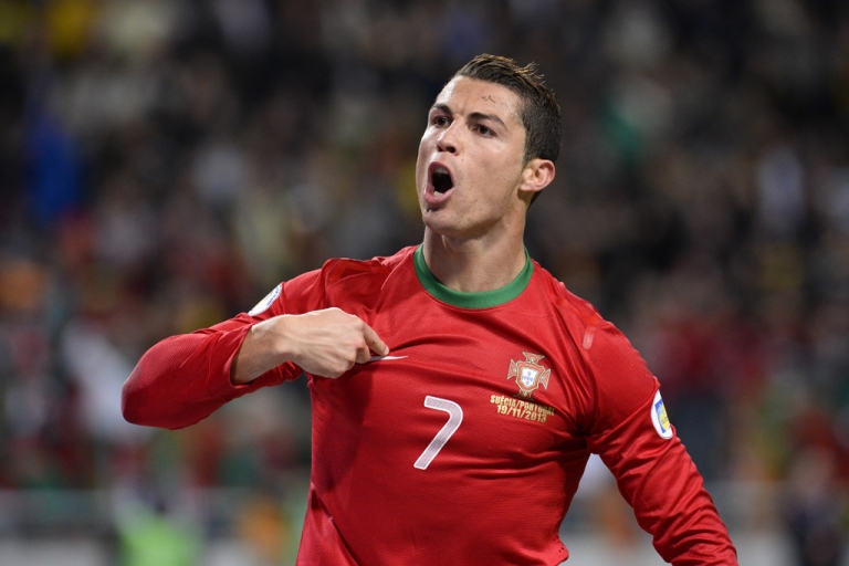 <p>Portugal's Cristiano Ronaldo celebrates after scoring his second goal during a World Cup playoff against Sweden at Friends Arena near Stockholm on November 19, 2013.</p>