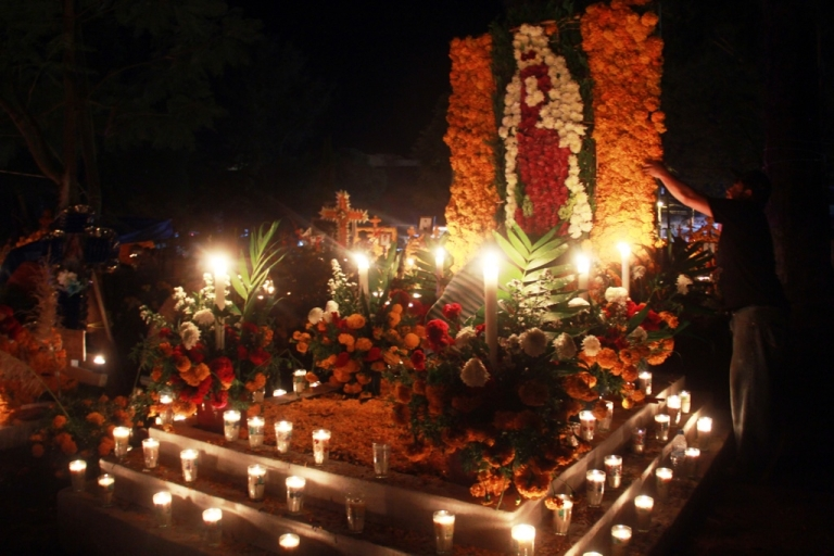 <p>Flowers and candles adorn a cemetery in Tzintzuntzan, Michoacan state, Mexico.</p>