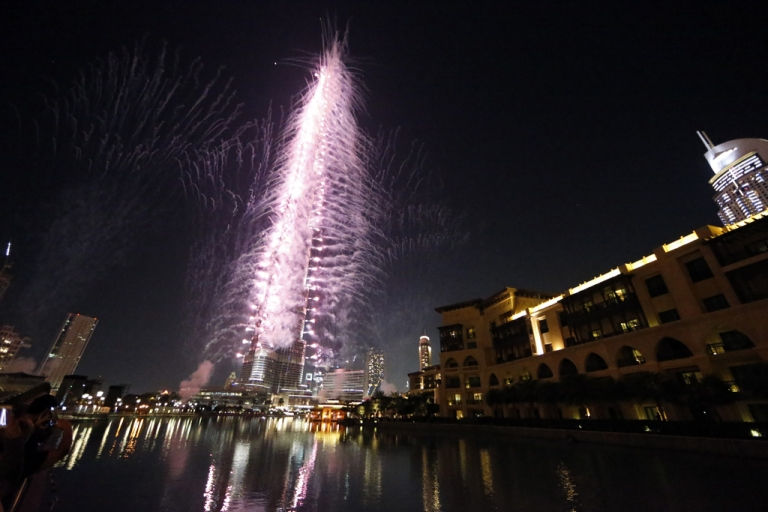 <p>Fireworks illuminate the sky around Dubai's Burj Khalifa, the world's tallest tower, on November 27, 2013, after the Emirati city was chosen to host the World Expo 2020. The Gulf city state beat Russia's Ekaterinberg in the final round of voting to clinch a prestigious event credited with delivering a huge boost to tourism and business for its host city.</p>