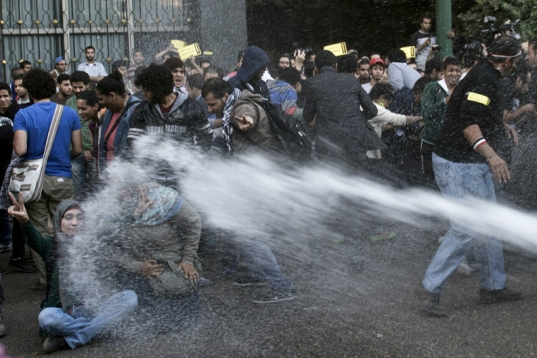 <p>Egyptian police use a water canon to disperse protesters during a demonstration organized by human rights group 'No Military Trials for Civilians' in front of the Shura Council in downtown Cairo on Nov. 26, 2013. A new law passed by Egypt's interim president Adly Mansour requires protesters to obtain permission to demonstrate three days in advance, and allows security forces to issue verbal warnings to protesters, then to use water cannons, tear gas and, finally, birdshot to disperse those who don't comply.</p>
