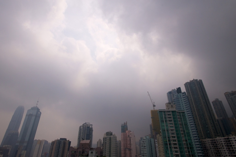 <p>The sun breaks through the clouds over Hong Kong on September 23, 2013.</p>
