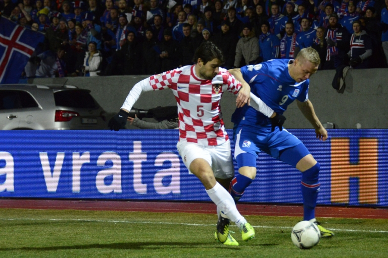 <p>Iceland's striker Kolbeinn Sigthorsson, right, and Croatian defender Vedran Corluka vie for the ball during their World Cup playoff in Reykjavik on November 15, 2013.</p>
