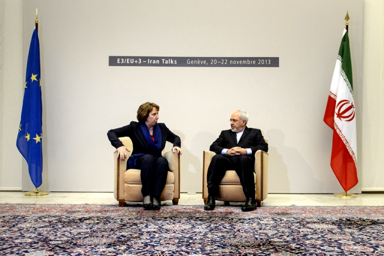 <p>EU foreign policy chief Catherine Ashton (L) sits next to Iranian Foreign Minister Mohammad Javad Zarif on November 20, 2013 at the start of closed-door nuclear talks in Geneva.</p>