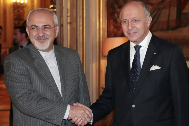 <p>French Foreign Minister Laurent Fabius, right, welcomes his Iranian counterpart Mohammad Javad Zarif to the Quai d'Orsay Foreign ministry on November 5, 2013 in Paris.</p>