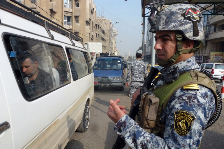 <p>Iraqi security forces stop a man at a checkpoint in central Baghdad on November 27, 2013, as violence in the Iraqi capital left 19 people dead, including a family of five.</p>