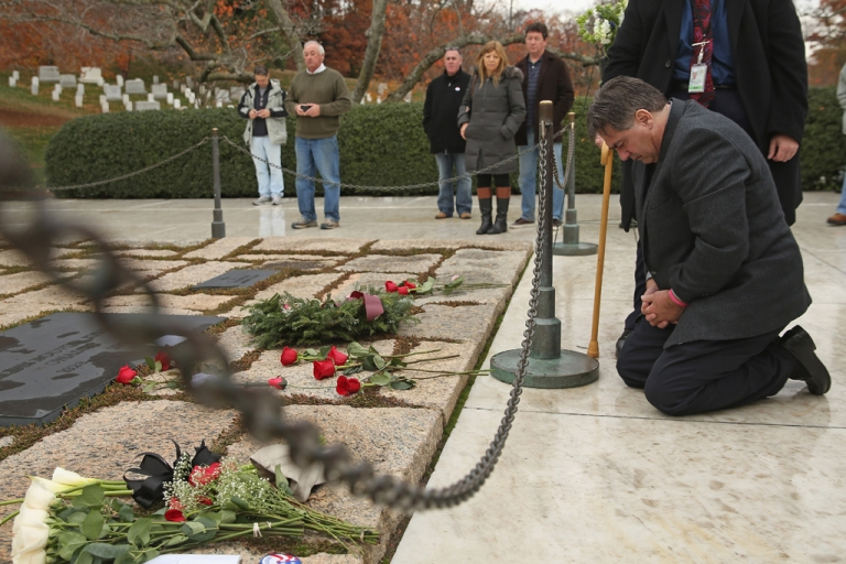 <p>Herman Whalen Jr. of Syracuse, N.Y., kneels at the gravesite of former President John F. Kennedy, his wife Jaqueline Kennedy and other family members at Arlington National Cemetery on Nov. 22, 2013 in Arlington, Virginia. When he was a boy in 1963, Whalen and his family layed a wreath at the gravesite.</p>